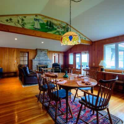 Dining room has seating for up to 8 and has cathedral ceilings